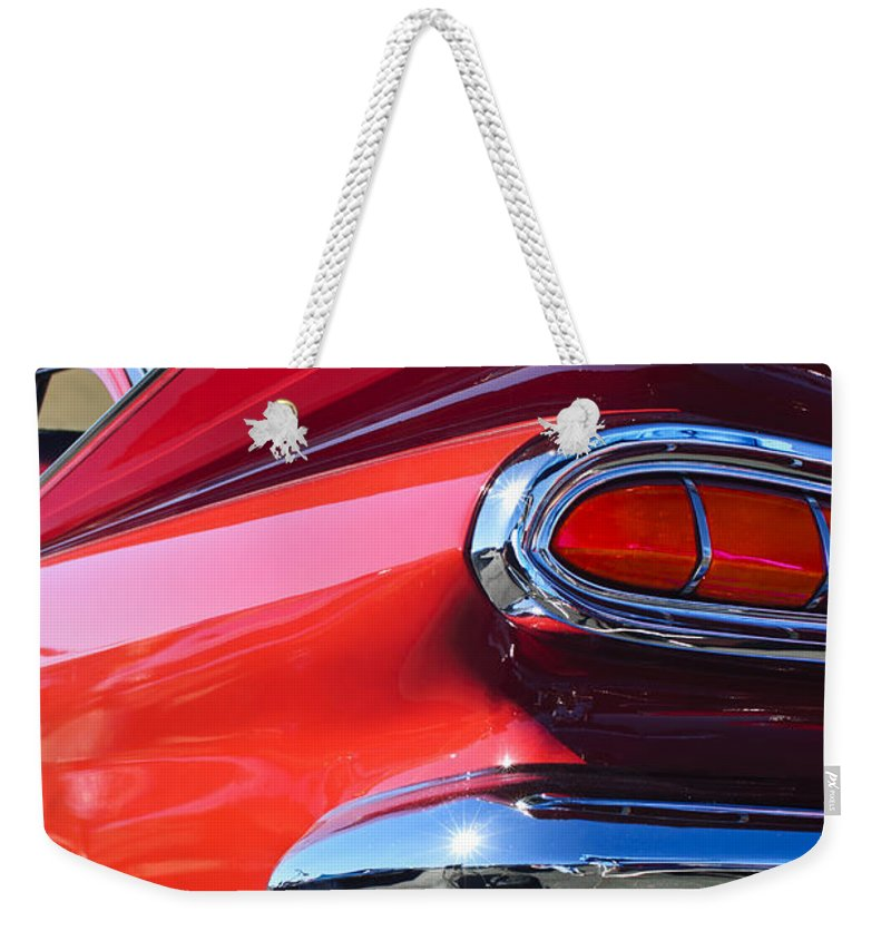 1959 Chevrolet Biscayne Weekender Tote Bag featuring the photograph 1959 Chevrolet Biscayne Taillight by Jill Reger