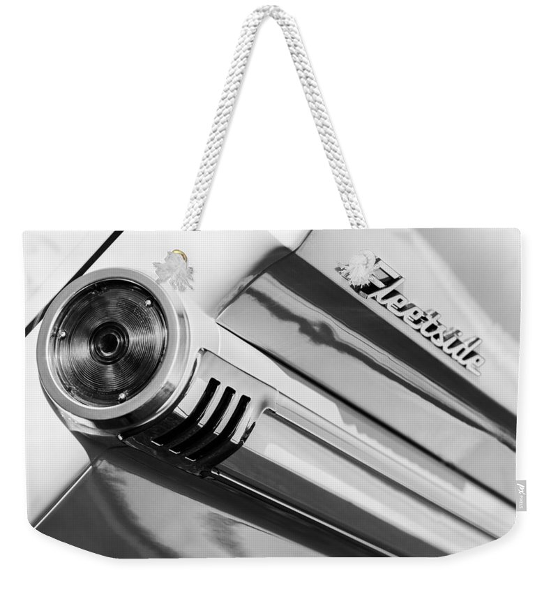 1959 Chevrolet Napco Fleetside Tail Light Emblem Weekender Tote Bag featuring the photograph 1959 Chevrolet Napco Fleetside Tail Light Emblem -1564bw by Jill Reger