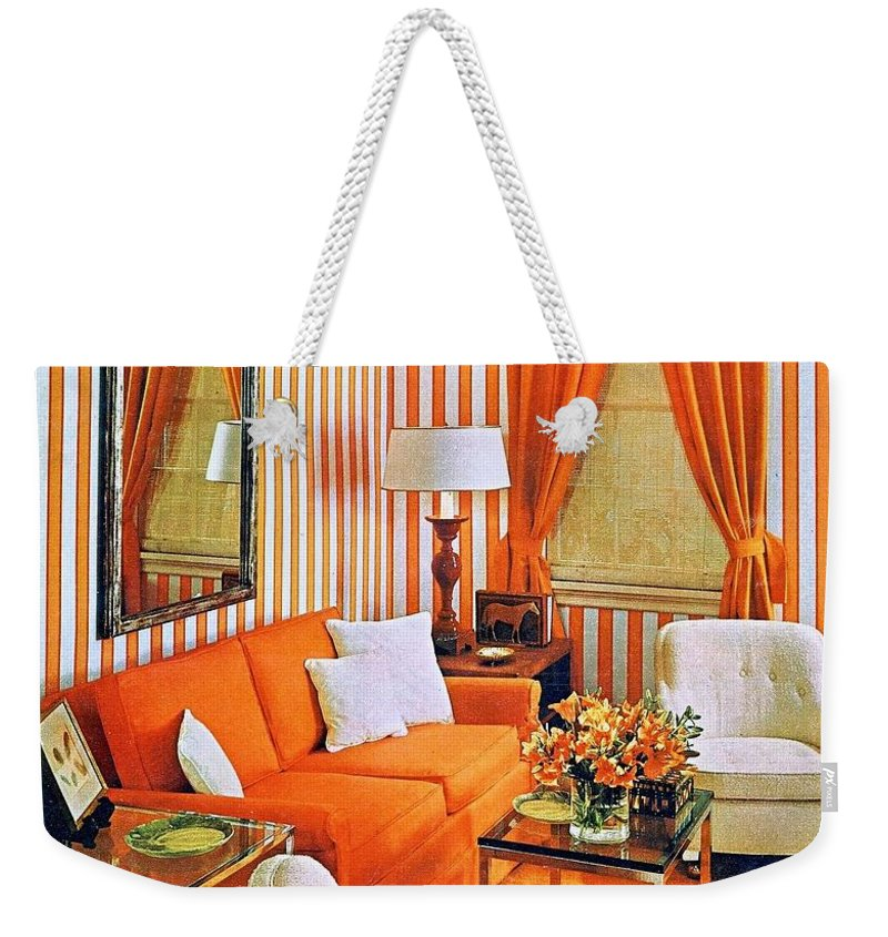 1960 70 Stylish Weekender Tote Bag featuring the photograph 1960 70 Stylish Living Room Advertisement Orange And Stripes Groovy Baby by R Muirhead Art