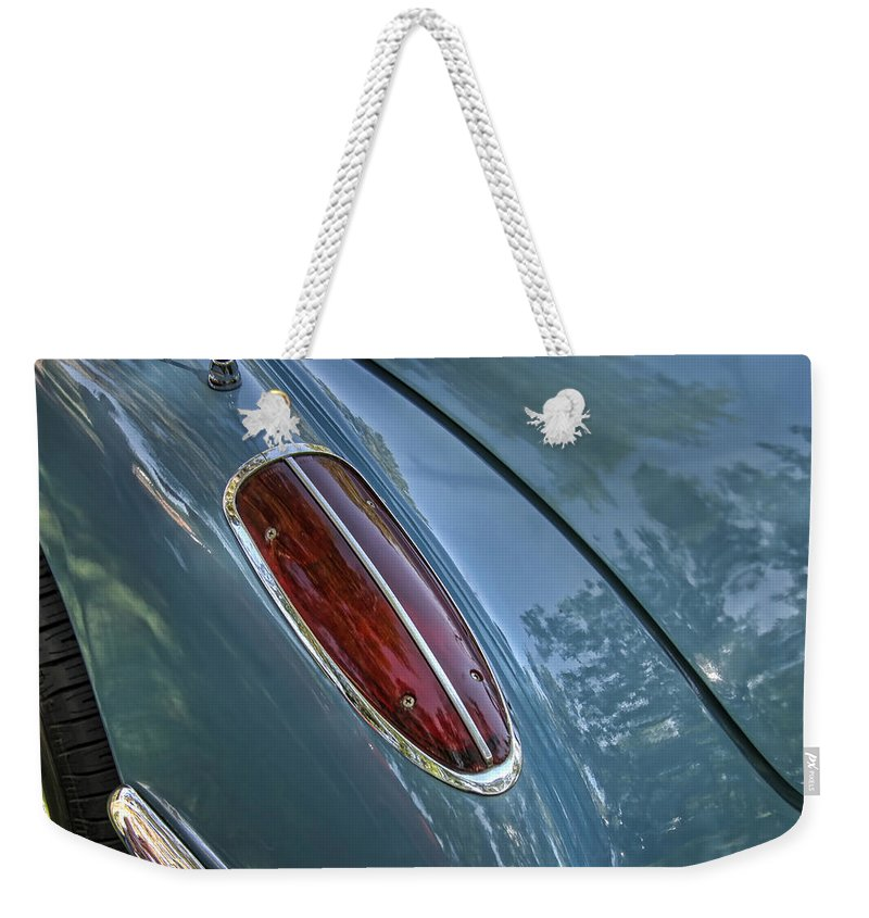 1960 Weekender Tote Bag featuring the photograph 1960 Chevrolet Corvette Tail Light by Nick Gray