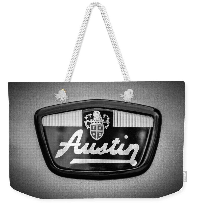 1961 Austin Mini Emblem Weekender Tote Bag featuring the photograph 1961 Austin Mini Emblem -0953bw 1961 by Jill Reger