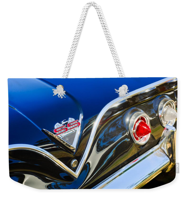 1961 Chevrolet Bel Air Impala Ss Bubble Top Tail Light Emblem Weekender Tote Bag featuring the photograph 1961 Chevrolet Bel Air Impala Ss Bubble Top Tail Light Emblem -0249c by Jill Reger