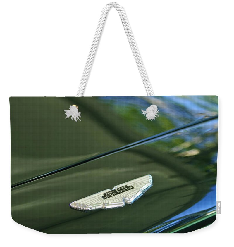 1967 Aston Martin Db6 Coupe Weekender Tote Bag featuring the photograph 1967 Aston Martin Db6 Coupe Hood Emblem by Jill Reger