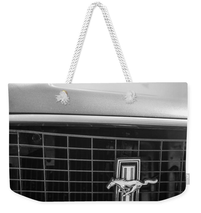 1969 Ford Mustang Grille Emblem Weekender Tote Bag featuring the photograph 1969 Ford Mustang Grille Emblem -0133bw by Jill Reger