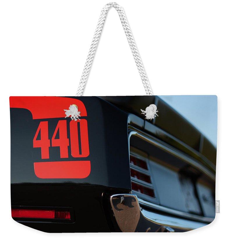 Black Weekender Tote Bag featuring the photograph 1970 Plymouth 'cuda 440 by Gordon Dean II