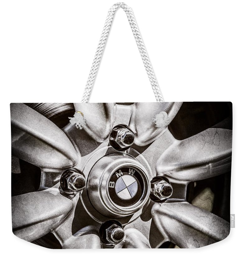 1974 Bmw 2002 Wheel Emblem Weekender Tote Bag featuring the photograph 1974 Bmw 2002 Wheel Emblem -2416ac by Jill Reger