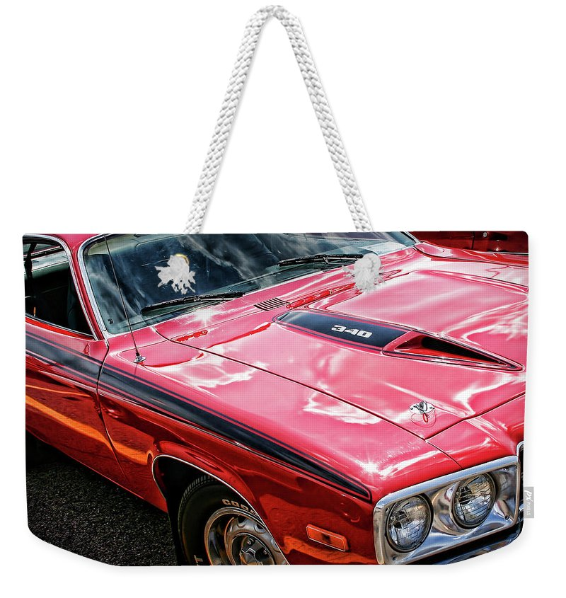 1971 Weekender Tote Bag featuring the photograph 1974 Plymouth Road Runner 340 by Gordon Dean II