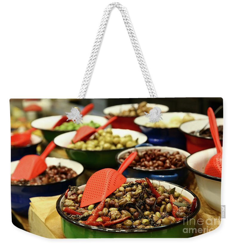 Food Weekender Tote Bag featuring the photograph A Bowl Of Black Olives by Oren Shalev