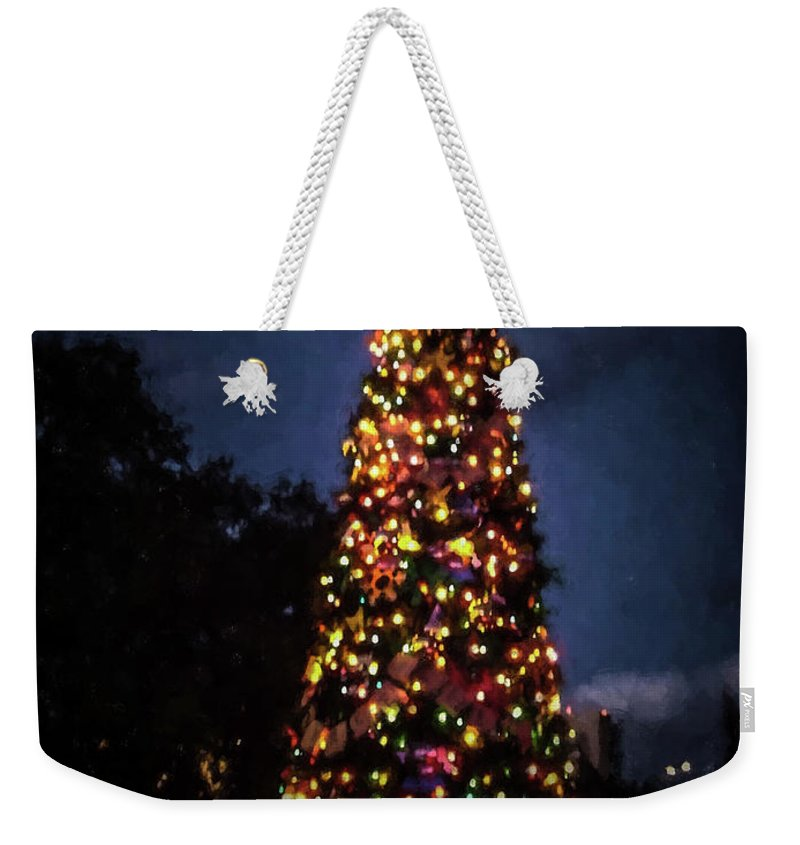 Epcot Weekender Tote Bag featuring the photograph An Epcot Christmas Tree by Tommy Anderson