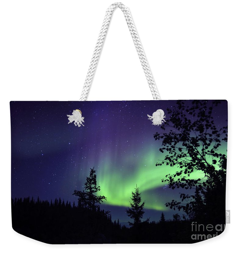 Yellowknife Weekender Tote Bag featuring the photograph Aurora Borealis Above The Trees by Jiri Hermann