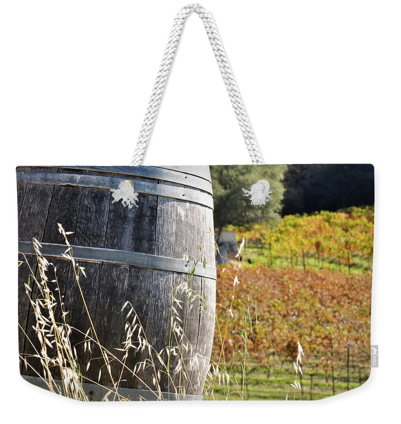 Beer Weekender Tote Bag featuring the photograph Barrel In The Vineyard by Brandon Bourdages