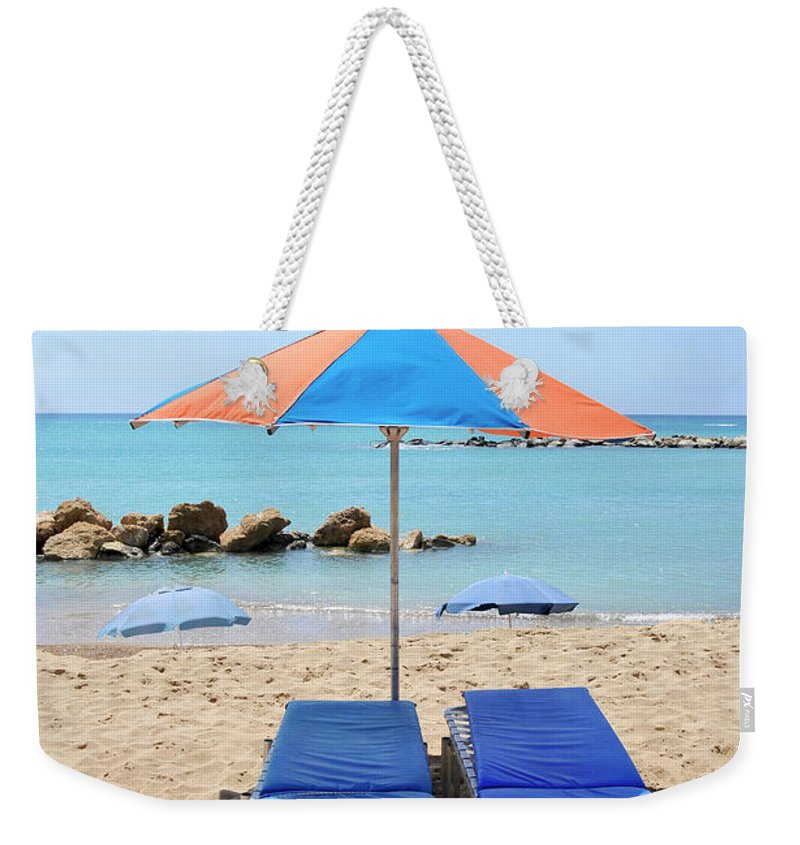 Tranquility Weekender Tote Bag featuring the photograph Beach Resort by Shay Levy