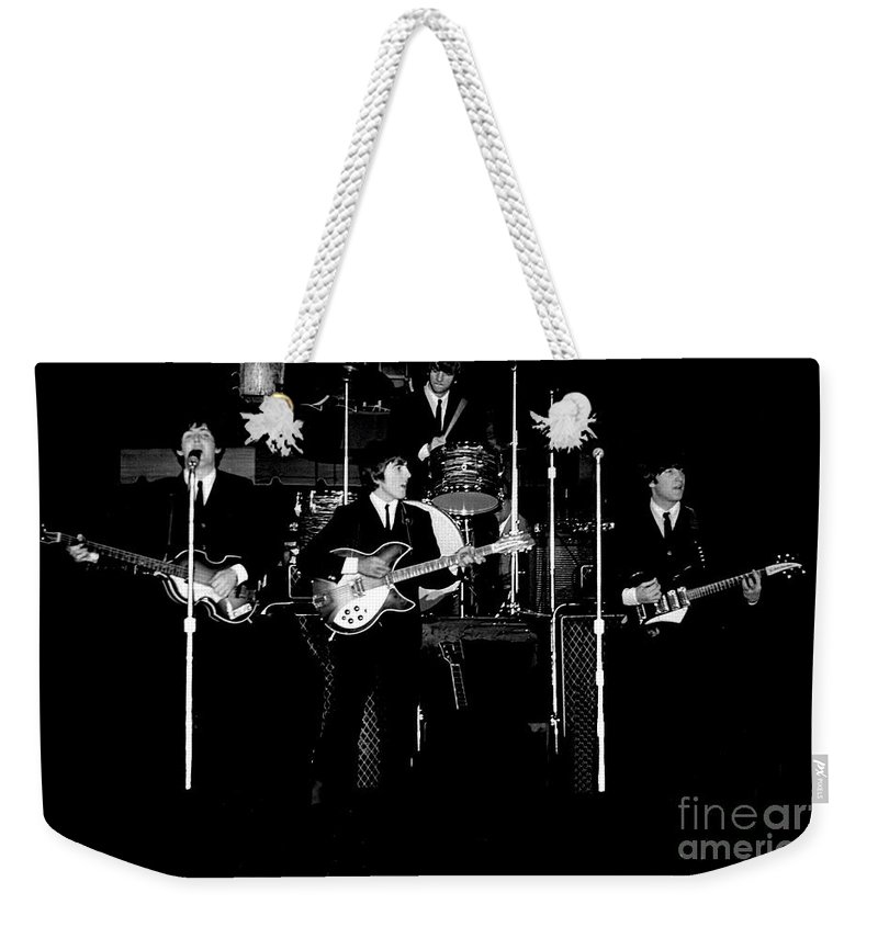 Beatles Weekender Tote Bag featuring the photograph Beatles In Concert 1964 by Larry Mulvehill