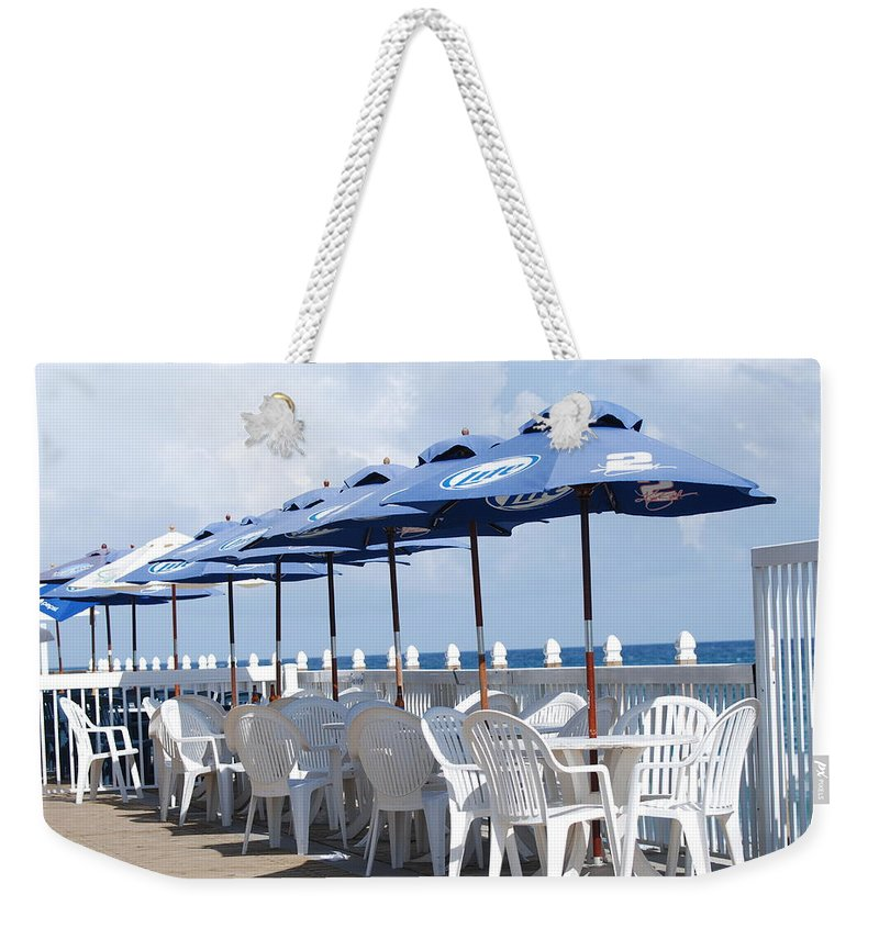 Chairs Weekender Tote Bag featuring the photograph Beer Unbrellas by Rob Hans