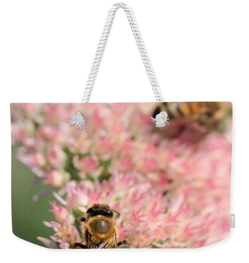 Bee Weekender Tote Bag featuring the photograph 2 Bees by Angela Rath