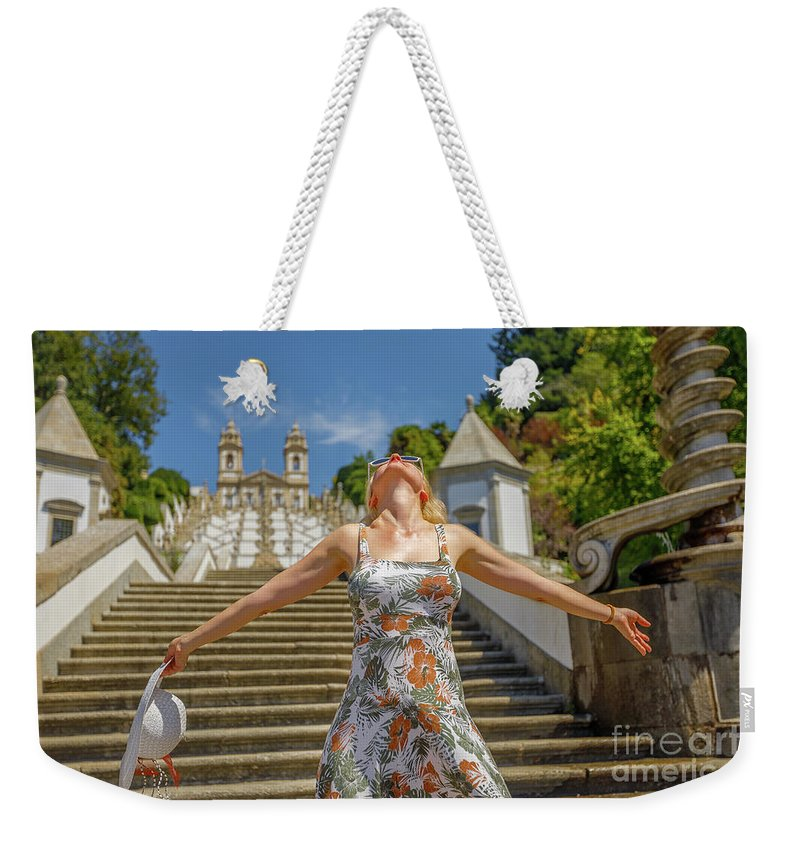 Braga Weekender Tote Bag featuring the photograph Braga Portugal Woman by Benny Marty