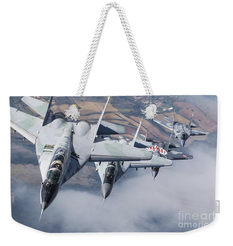 Bulgaria Weekender Tote Bag featuring the photograph Bulgarian And Polish Air Force Mig-29s by Daniele Faccioli