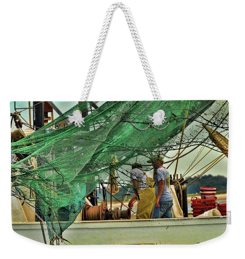 Weekender Tote Bag featuring the digital art Capt. Davis by Katheryn Batts