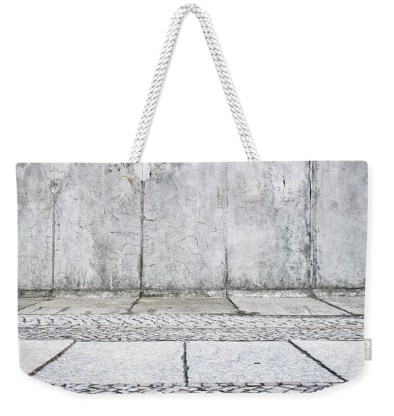 Abstract Weekender Tote Bag featuring the photograph Concrete Background by Tom Gowanlock