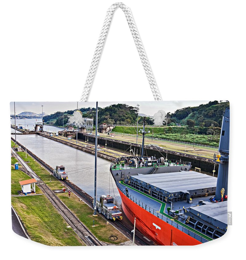 Crossing Weekender Tote Bag featuring the photograph Crossing Panama Canal by Tatiana Travelways