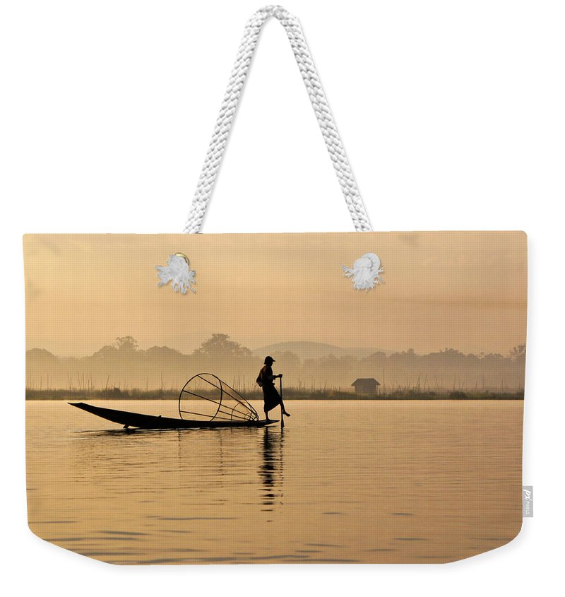 Asia Weekender Tote Bag featuring the photograph Dawn On Inle Lake by Michele Burgess