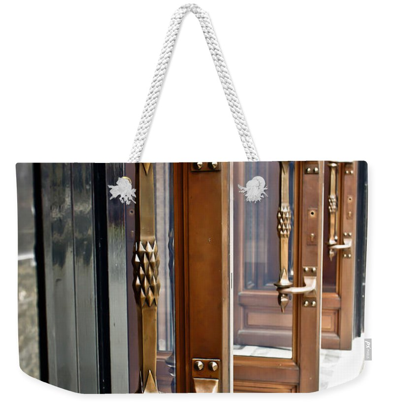 Abstract Weekender Tote Bag featuring the photograph Doors by Tom Gowanlock