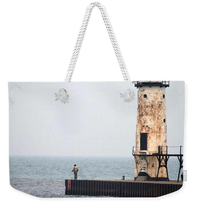 Manistee Weekender Tote Bag featuring the photograph End Of The Pier by Linda Kerkau