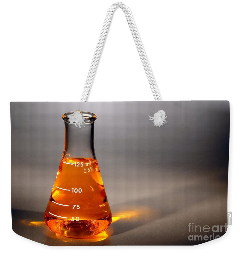 Scientific Weekender Tote Bag featuring the photograph Equipment In Science Research Lab by Olivier Le Queinec