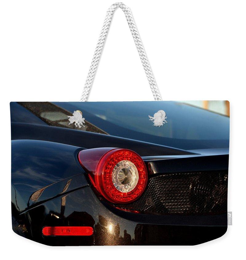 Weekender Tote Bag featuring the photograph Ferrari Tail Light by Dean Ferreira