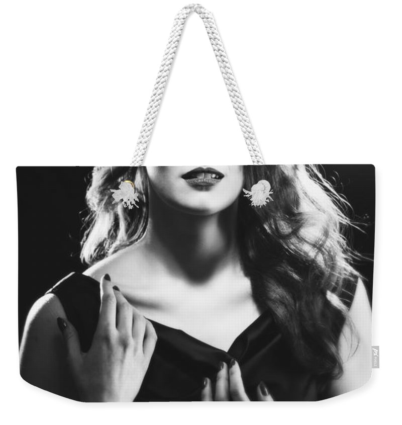 Hollywood Weekender Tote Bag featuring the photograph Film Noir Woman by Amanda Elwell