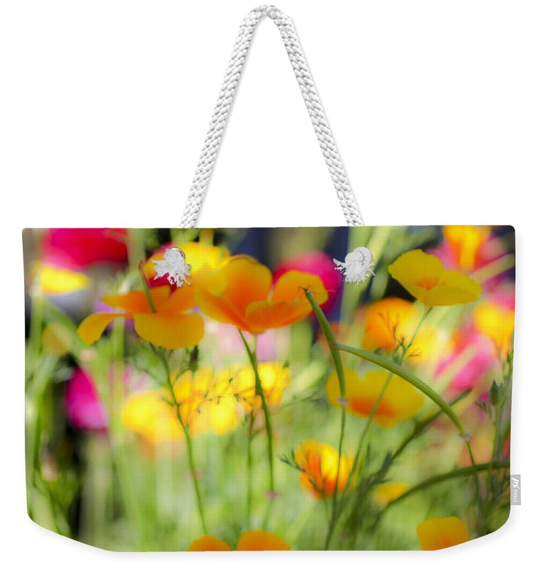 Yellow Weekender Tote Bag featuring the photograph Flowering Garden by Gal Eitan