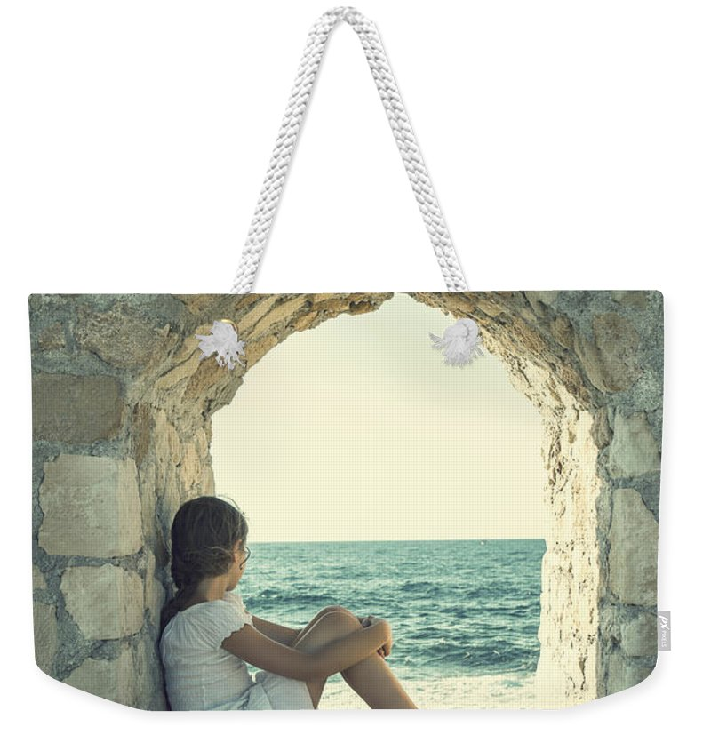 Female Weekender Tote Bag featuring the photograph Girl At The Sea 2 by Joana Kruse