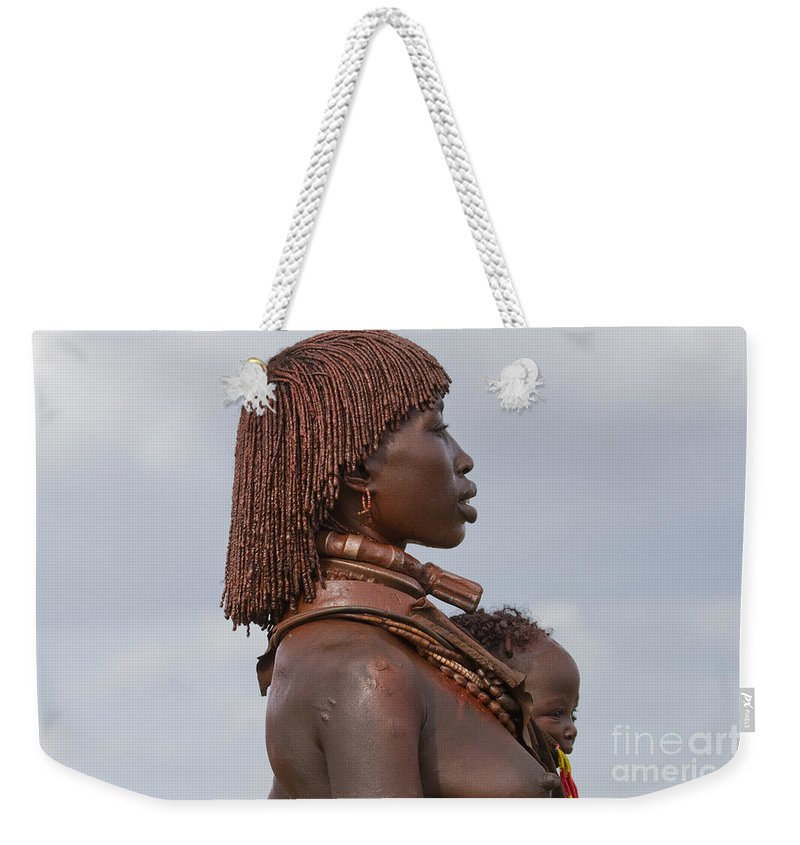 Hammere Weekender Tote Bag featuring the photograph Hamer Tribe Woman, Ethiopia by Eyal Bartov