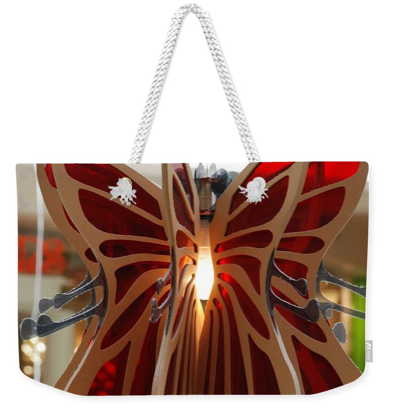 Butterfly Weekender Tote Bag featuring the photograph Hanging Butterfly by Rob Hans