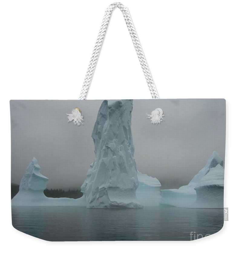 Icebergs Newfoundland Weekender Tote Bag featuring the photograph Icebergs by Seon-Jeong Kim