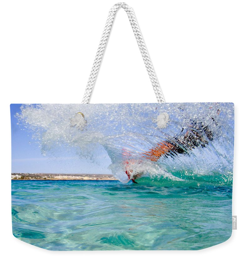 Adventure Weekender Tote Bag featuring the photograph Kitesurfing by Stelios Kleanthous