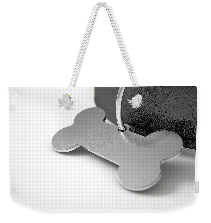Bone Weekender Tote Bag featuring the digital art Leather Collar With Tag by Allan Swart