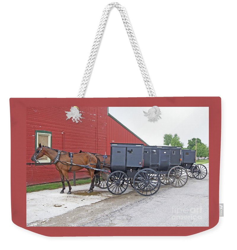 Amish Weekender Tote Bag featuring the photograph Amish Parking Lot by Ann Horn