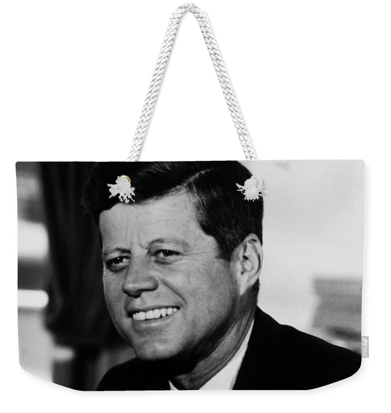 Jfk Weekender Tote Bag featuring the photograph President Kennedy by War Is Hell Store