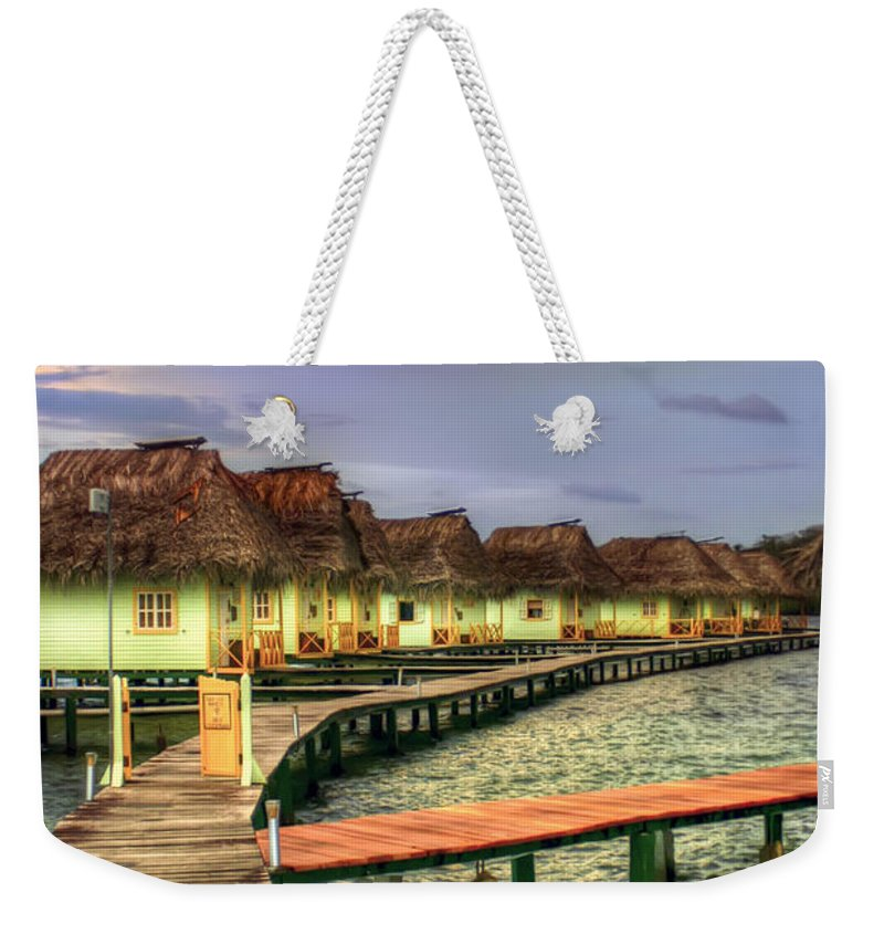 Punta Caracol Weekender Tote Bag featuring the photograph Punta Caracol by Dolly Sanchez