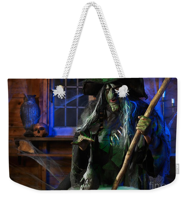 Witch Weekender Tote Bag featuring the photograph Scary Old Witch With A Cauldron by Oleksiy Maksymenko