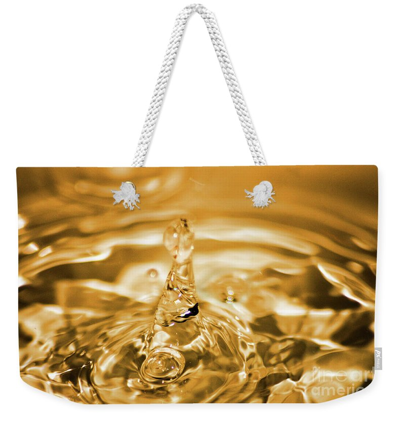 Water Weekender Tote Bag featuring the photograph Splash by Ilaria Andreucci