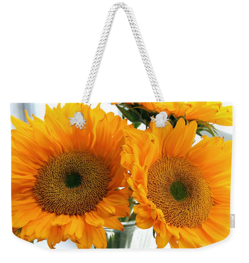 Sunflowers Weekender Tote Bag featuring the photograph Sunflowers by Todd Blanchard