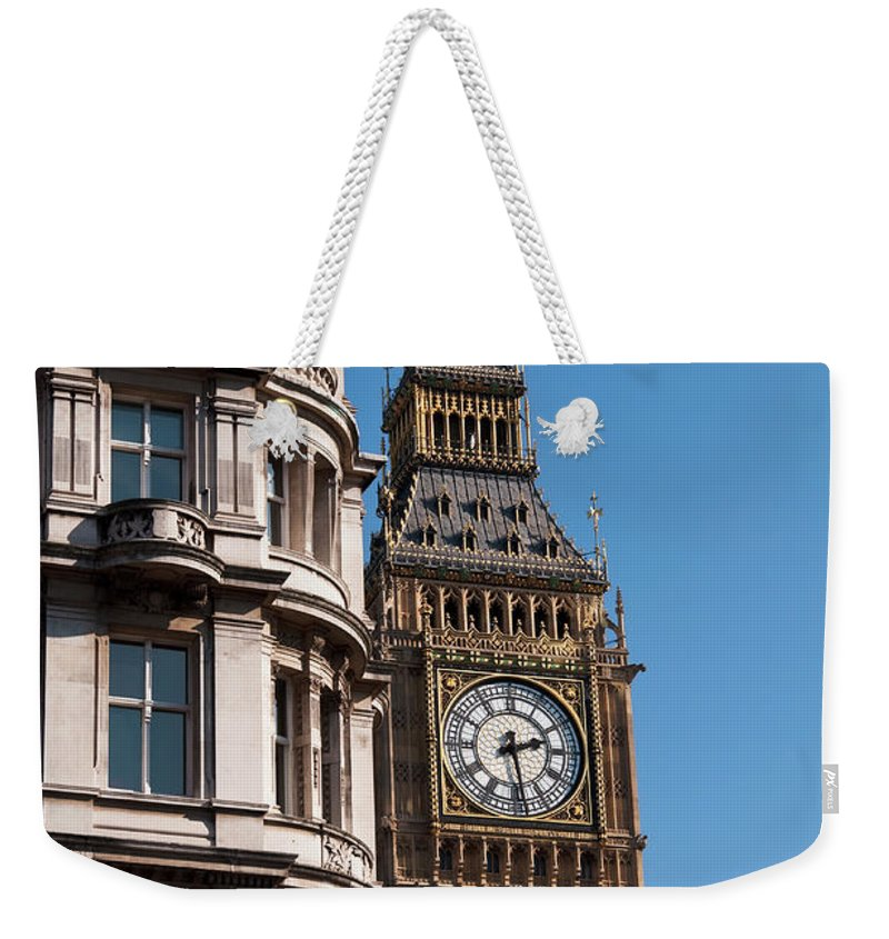London Weekender Tote Bag featuring the photograph The Clock Tower In London by Dutourdumonde Photography