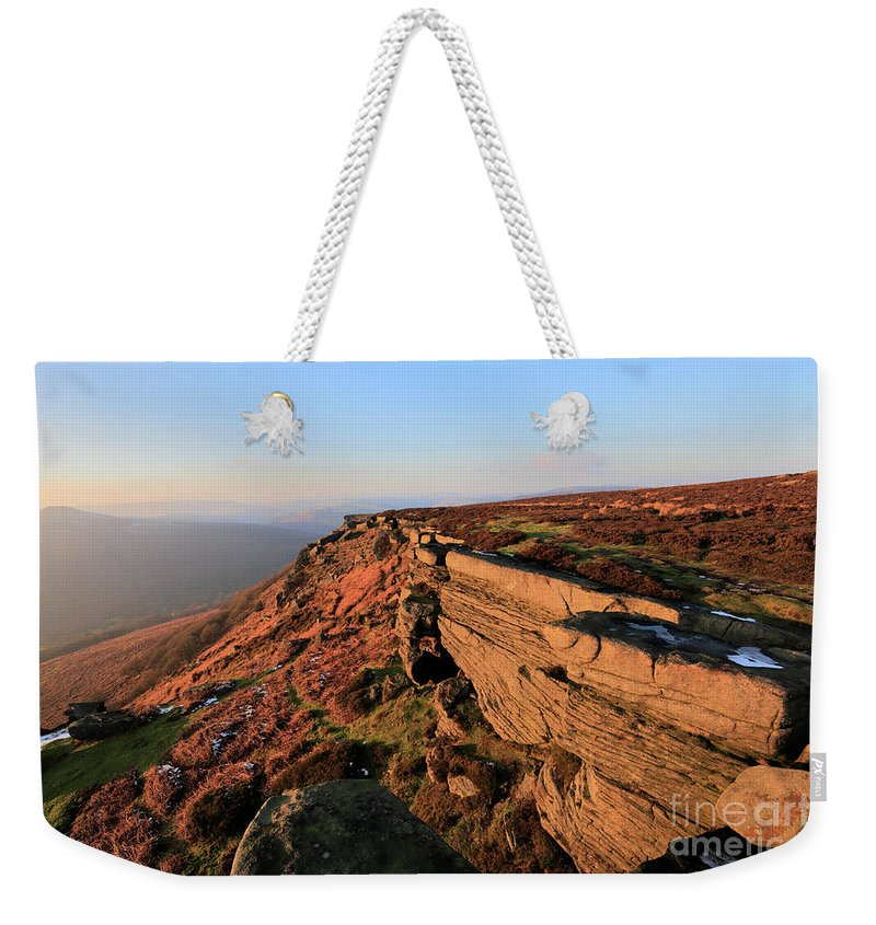 Stanage Edge Weekender Tote Bag featuring the photograph The Gritstone Rock Formations On Stanage Edge by Dave Porter