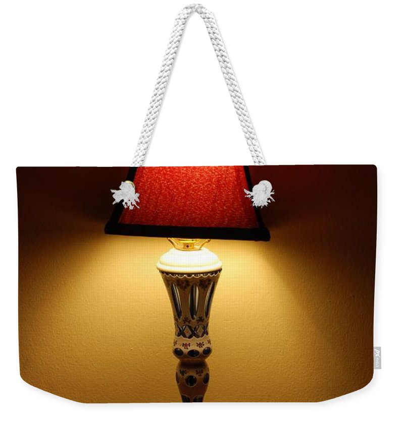 Lights Weekender Tote Bag featuring the photograph The Lamp by Rob Hans