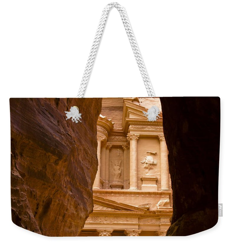 Middle East Weekender Tote Bag featuring the photograph The Treasury Of Petra by Michele Burgess