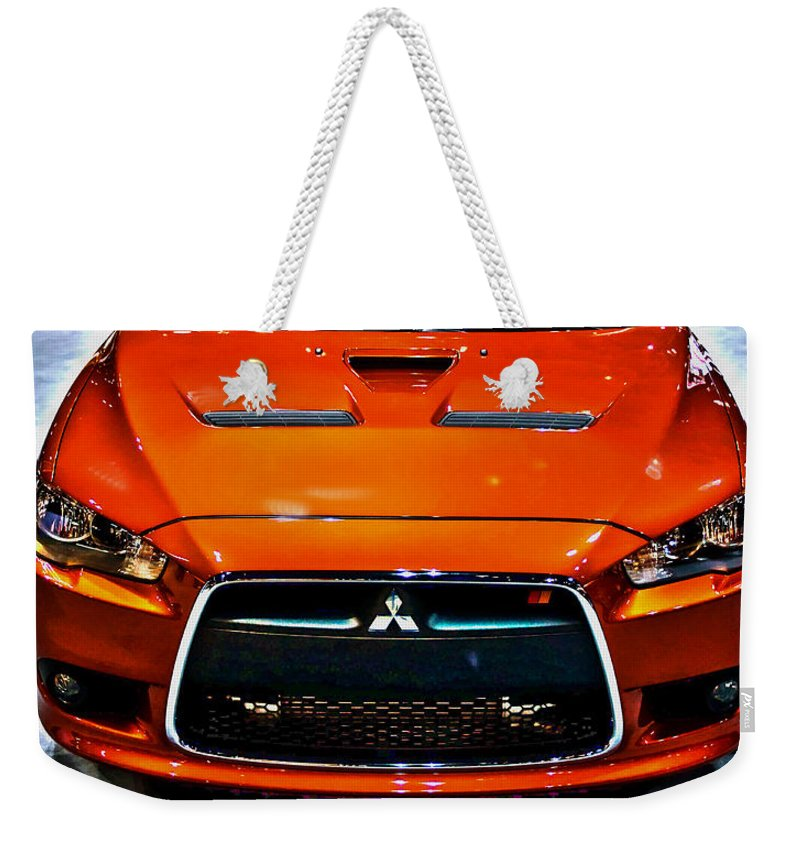 Automotive Weekender Tote Bag featuring the photograph 2009 Mitsubishi Lancer by Alan Look