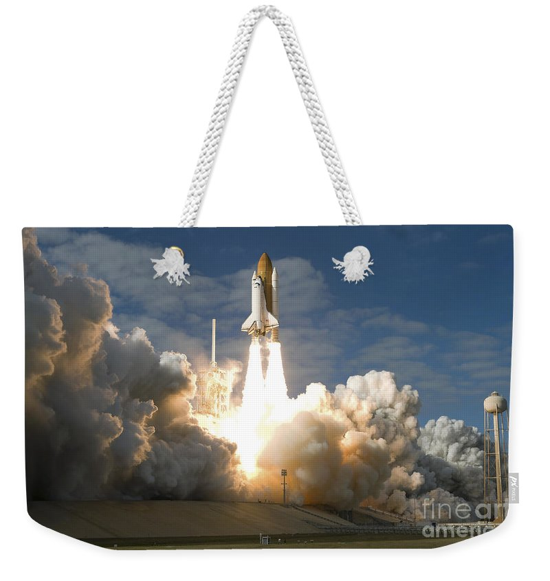 Taking Off Weekender Tote Bag featuring the photograph Space Shuttle Atlantis Lifts by Stocktrek Images