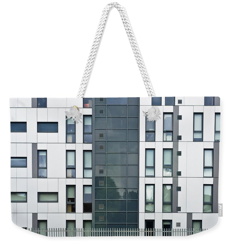 Architectural Weekender Tote Bag featuring the photograph Modern Building by Tom Gowanlock
